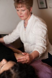 Craniosacral Therapy Session - pie ta left side